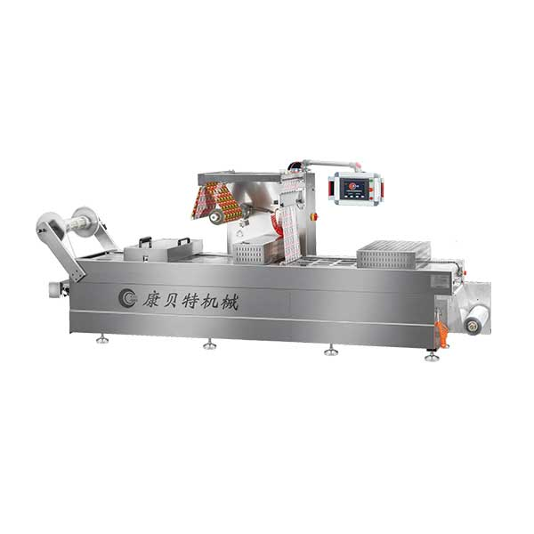 Thermoforming tray vacuum packaging machine