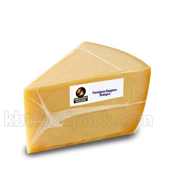 Cheese portion vacuum sealing machine
